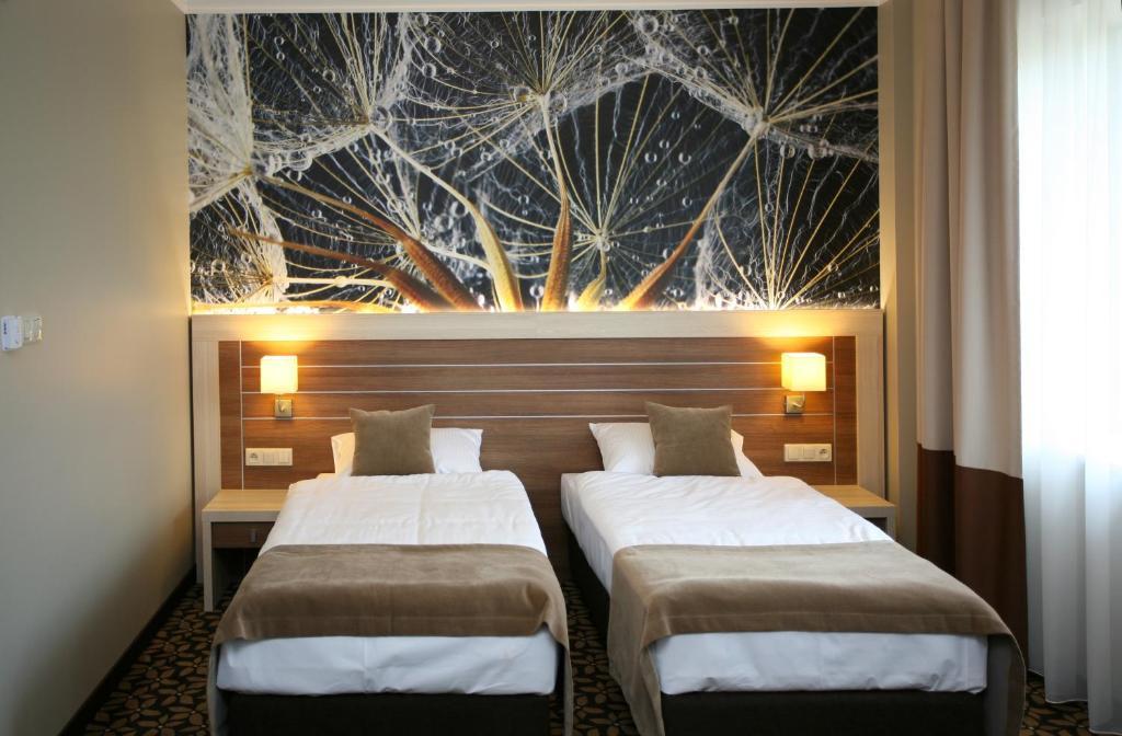 Кровать или кровати в номере Hotel Delfina