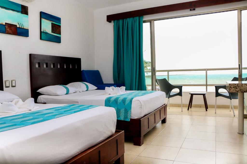 A bed or beds in a room at Playa Linda Hotel