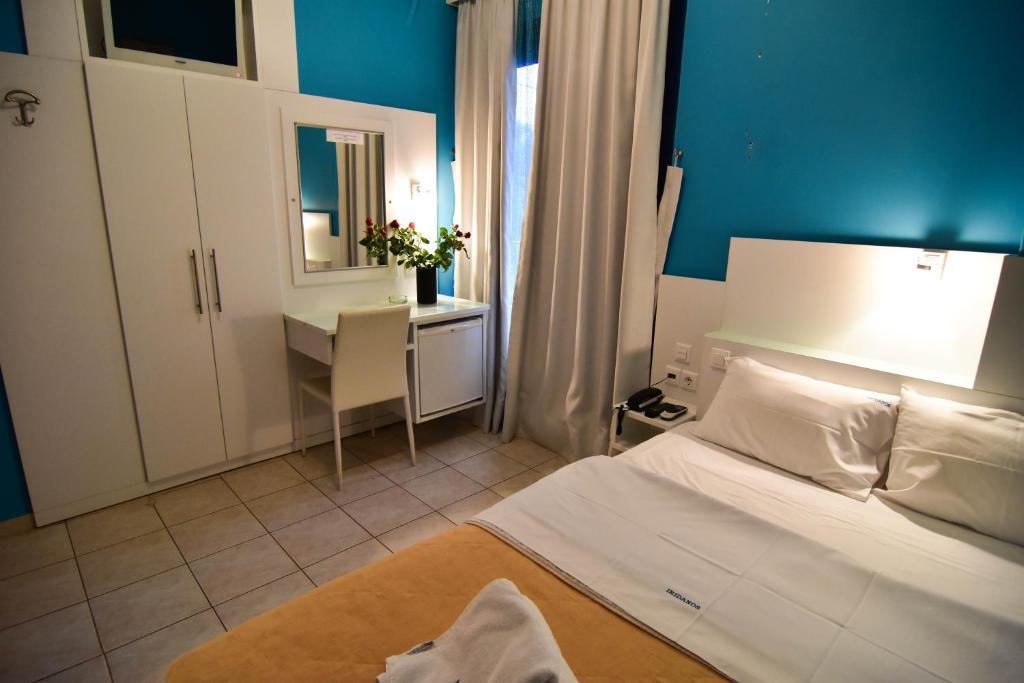 Ένα ή περισσότερα κρεβάτια σε δωμάτιο στο Iridanos