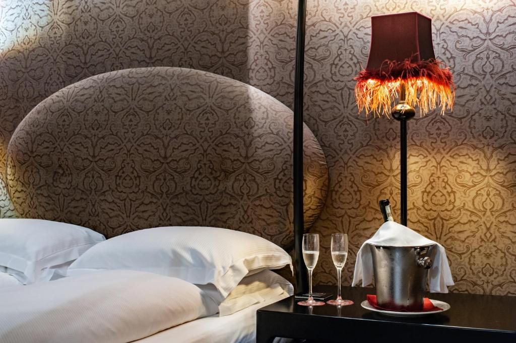 Letto o letti in una camera di Hotel Palazzo Barbarigo Sul Canal Grande