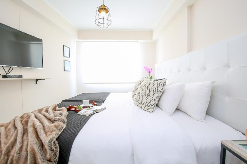 A bed or beds in a room at Trendy Host Osma, Barranco
