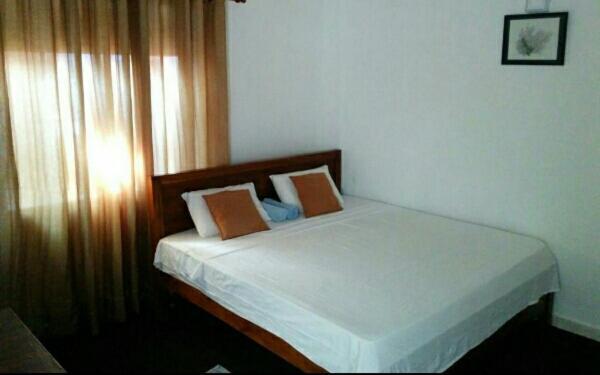 Triple One Villaにあるベッド