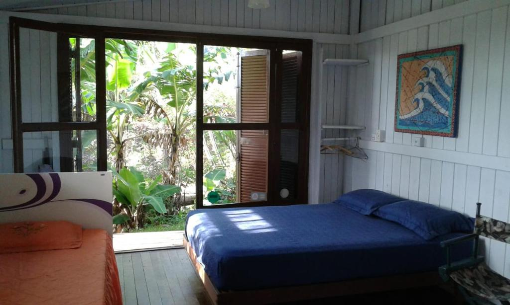 A bed or beds in a room at Praia do Siriu