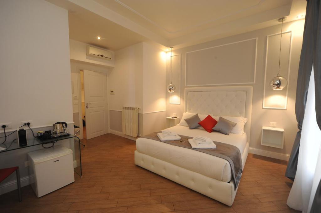 Letto o letti in una camera di My Suites Piazza di Spagna