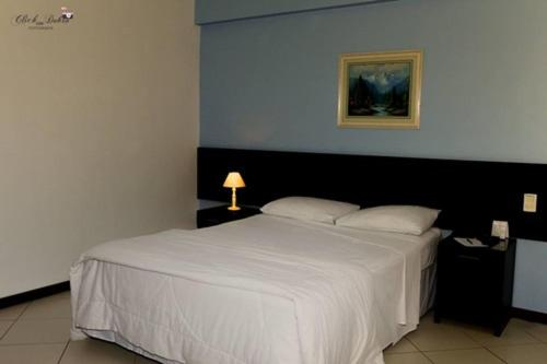 A bed or beds in a room at Crystal Apart Hotel