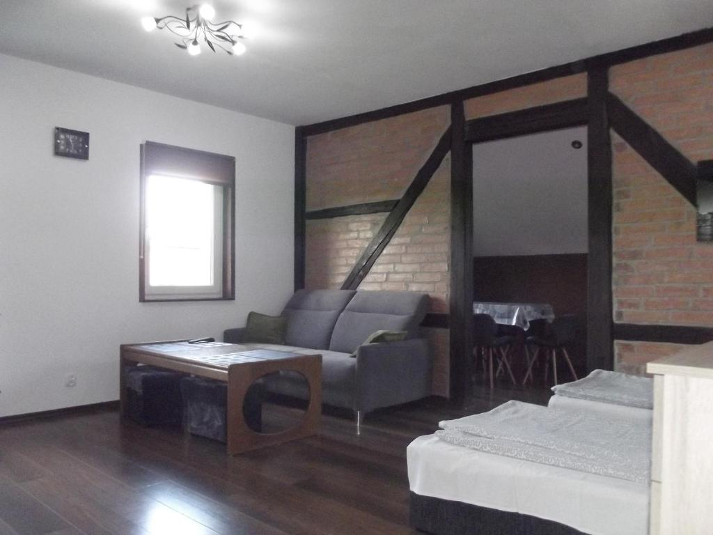 A bed or beds in a room at Kwatery 42