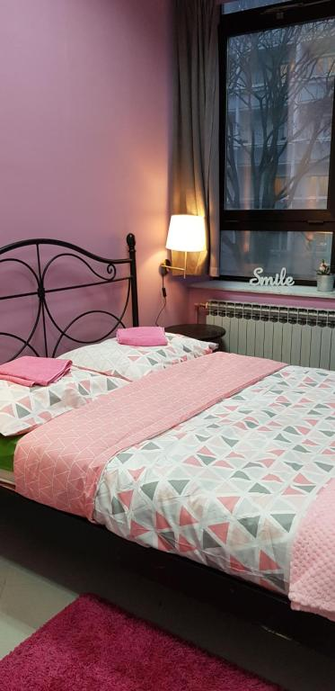 A bed or beds in a room at Fancy Hostel