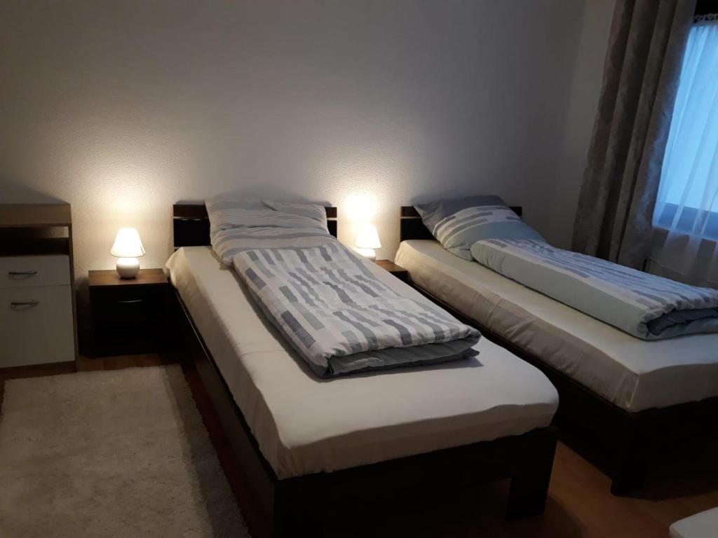Postel nebo postele na pokoji v ubytování David