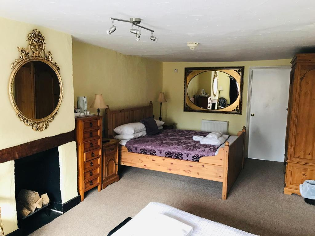 A bed or beds in a room at Longs Hotel & Inn