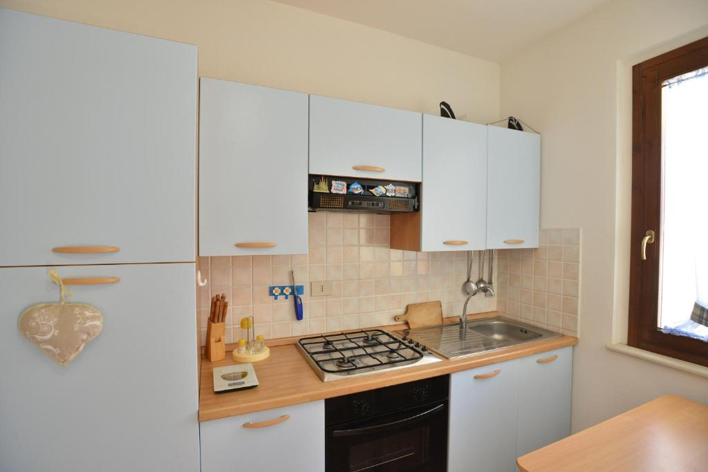 Küche/Küchenzeile in der Unterkunft IzzHome Crispi
