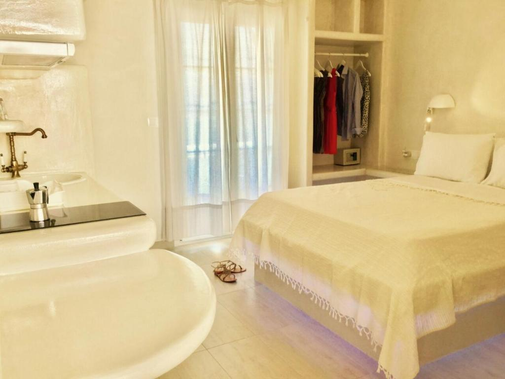 A bed or beds in a room at Deluxe Studios & Suites Ageri-Milos