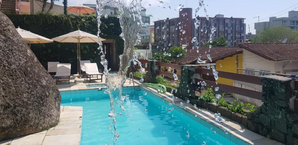 The swimming pool at or near Apartamentos Casa da Pedra