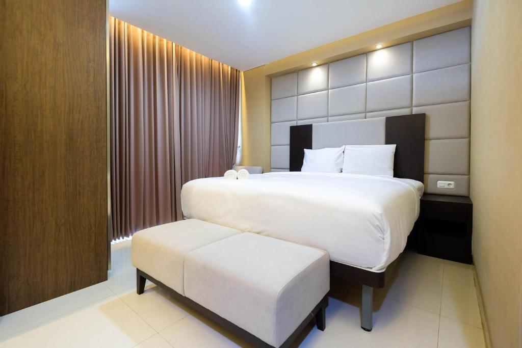 minimalist style studio brooklyn apartment near ikea alam sutera by travelio