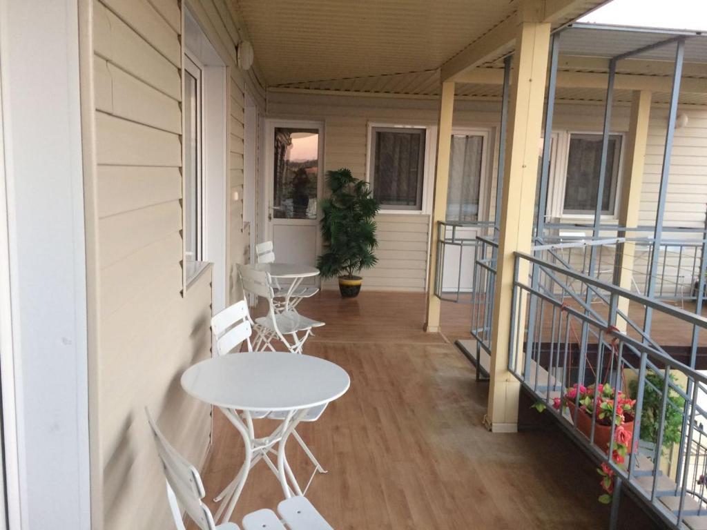 A balcony or terrace at Guest house Sibiriachka