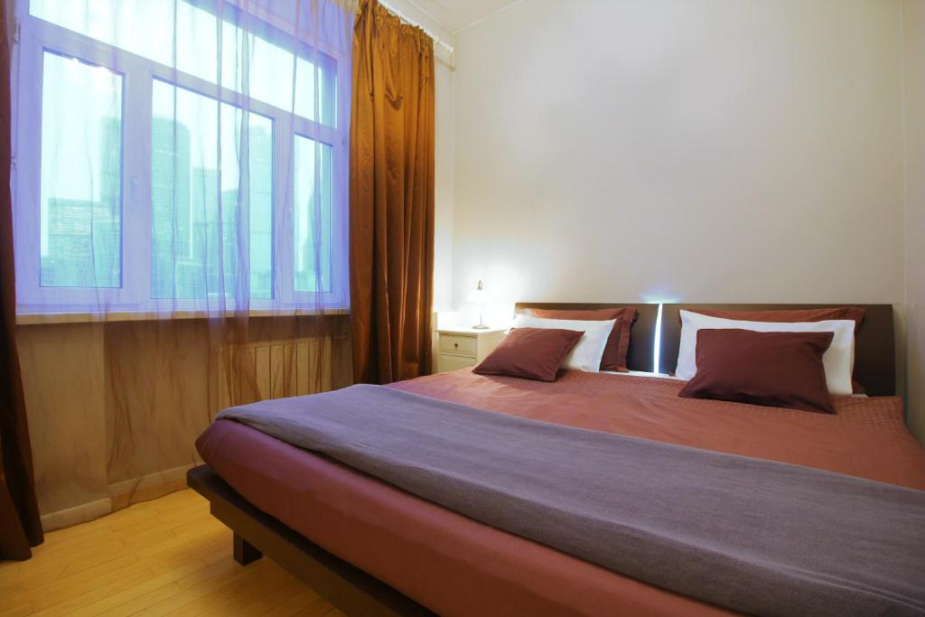 A bed or beds in a room at Business Apartment Moskva-city