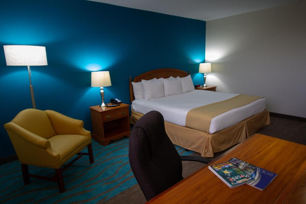 A bed or beds in a room at Caribe Hotel Ponce