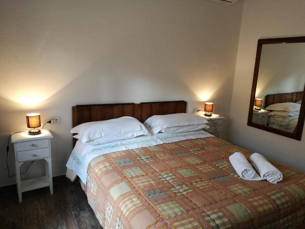 A bed or beds in a room at B&B da Caddalina