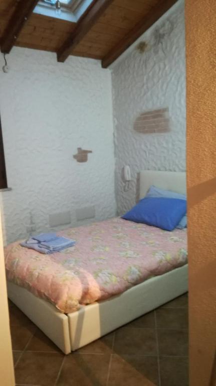 A bed or beds in a room at SA DOMEDDA