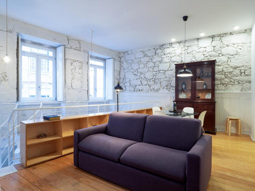 A seating area at APA D - Loft Guesthouse Jardim das Maes Charming
