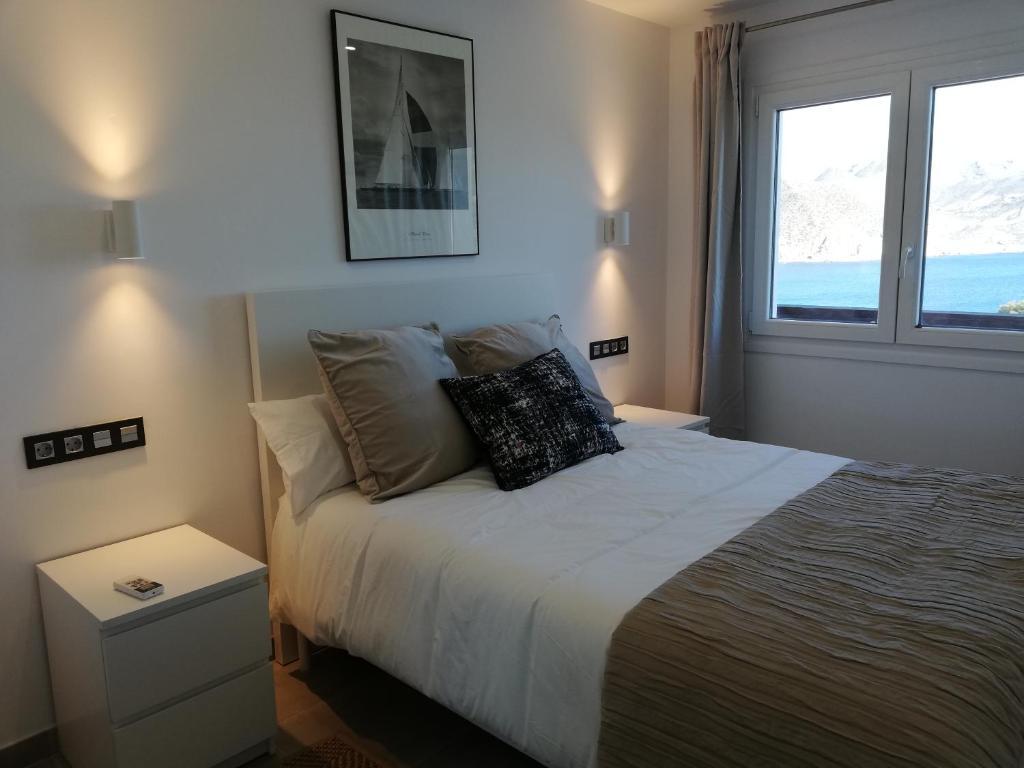 Cama o camas de una habitación en EL FARO DE LOS GENOVESES