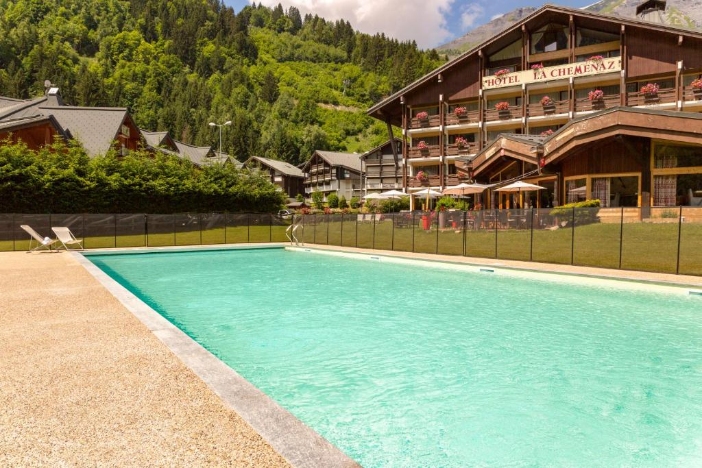 The swimming pool at or near Chalet-Hôtel La Chemenaz, The Originals Relais (Hotel-Chalet de Tradition)
