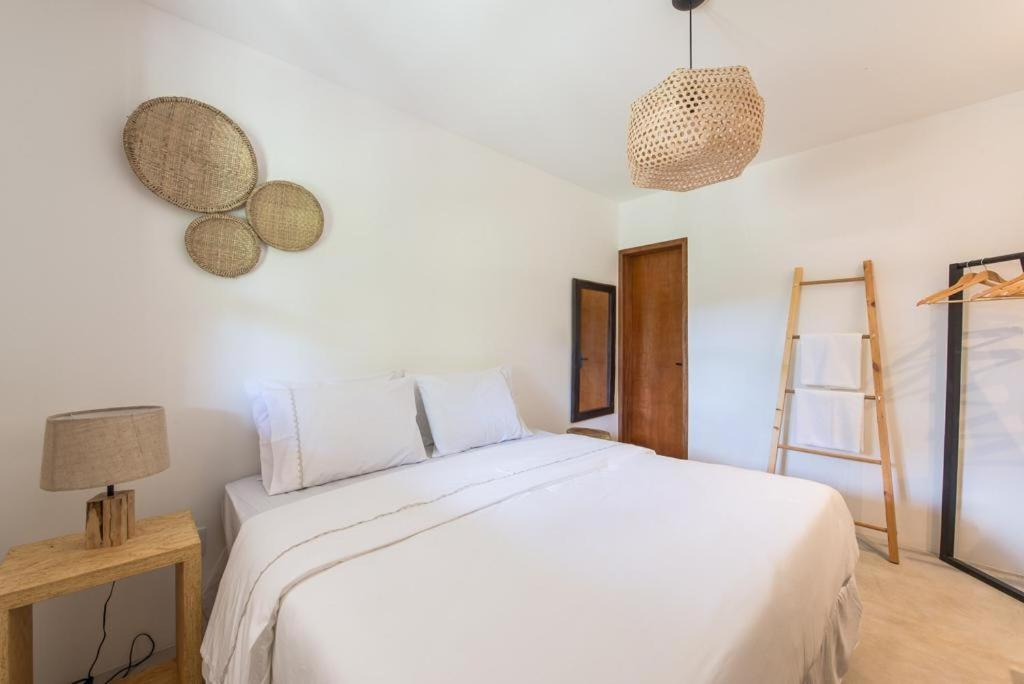A bed or beds in a room at Noronha 350