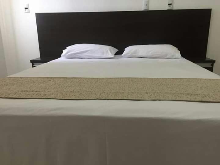 A bed or beds in a room at Hotel Cruzeiro de São José