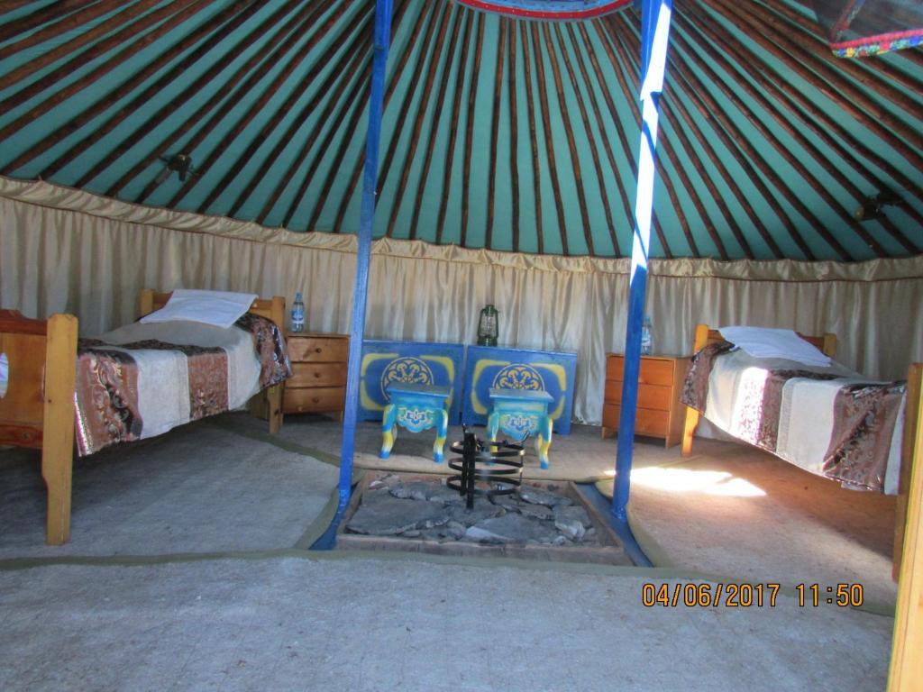 Кровать или кровати в номере Yurt-complex Biy-Khem