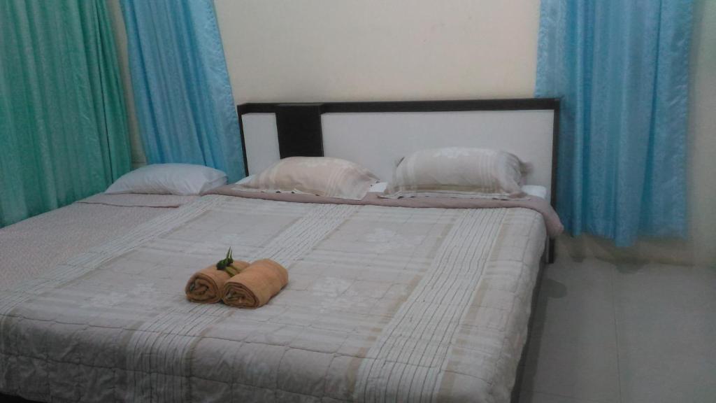 Кровать или кровати в номере Banburee House