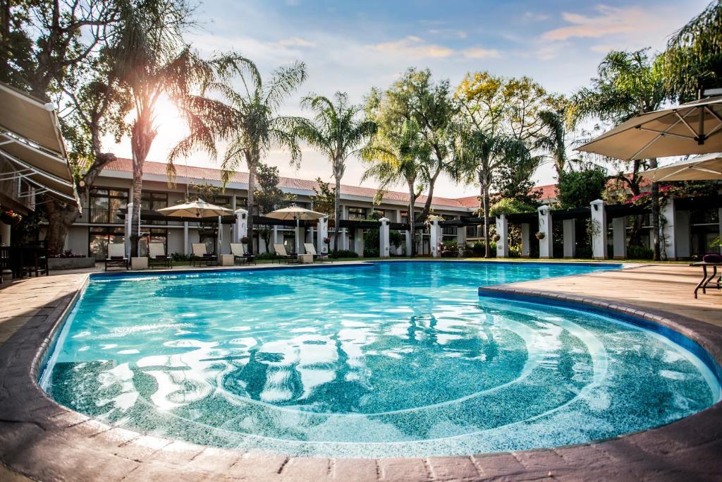 The swimming pool at or near Avani Gaborone Resort & Casino