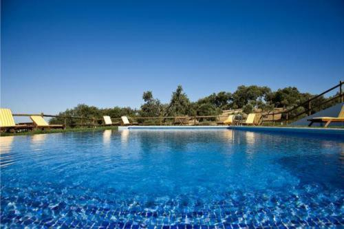 The swimming pool at or near Hotel Quinta Dos Bastos