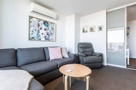 A seating area at Fantastic views, 2 b/r, 2 bath with all new furniture