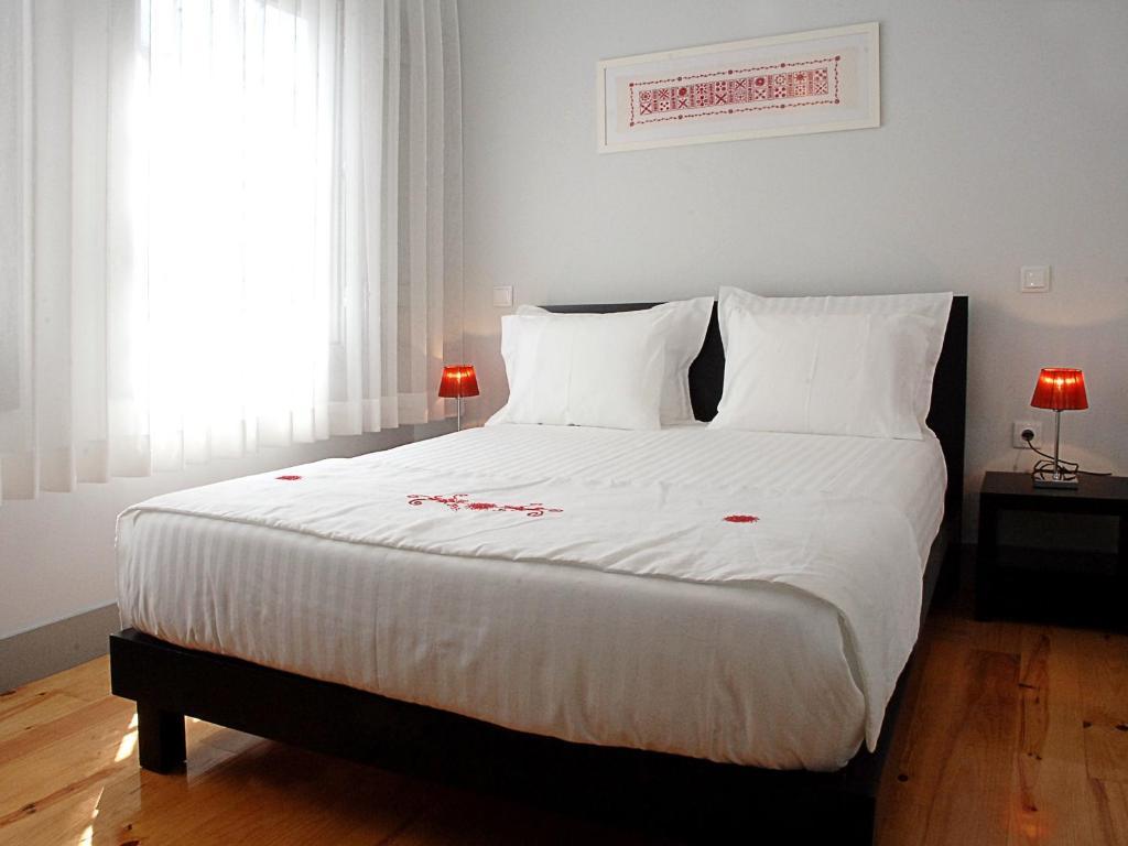 Cama ou camas em um quarto em Guest House Vimaranes