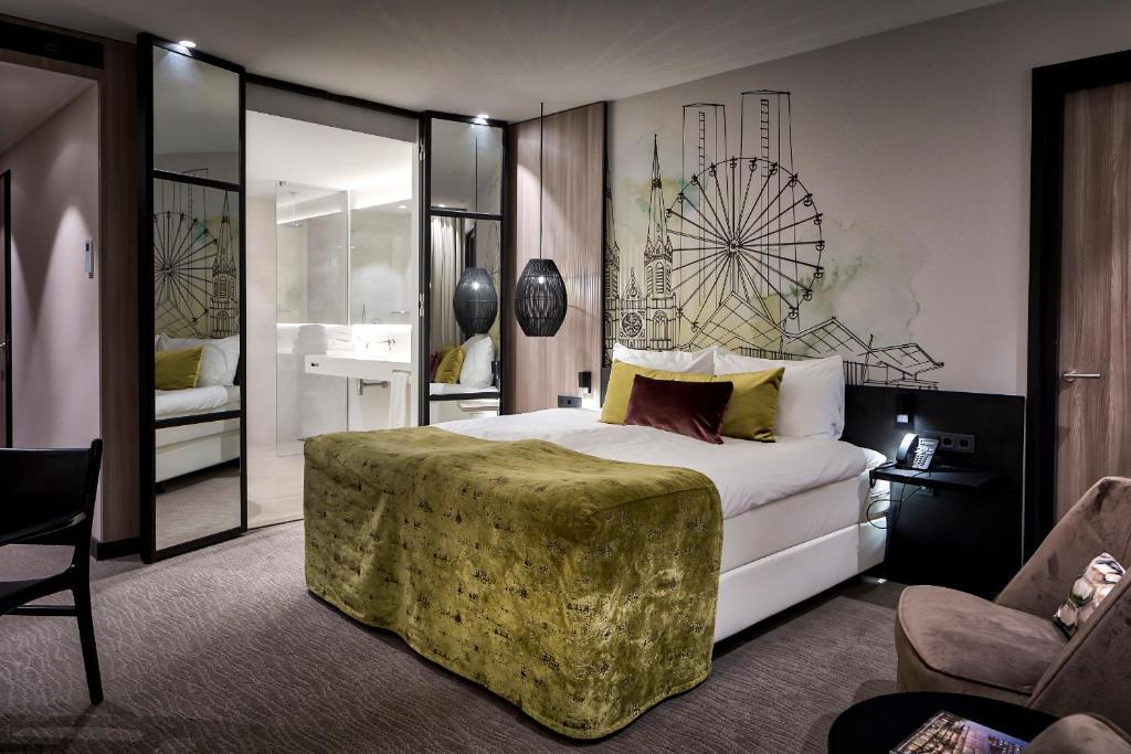 A bed or beds in a room at Van der Valk Hotel Tilburg