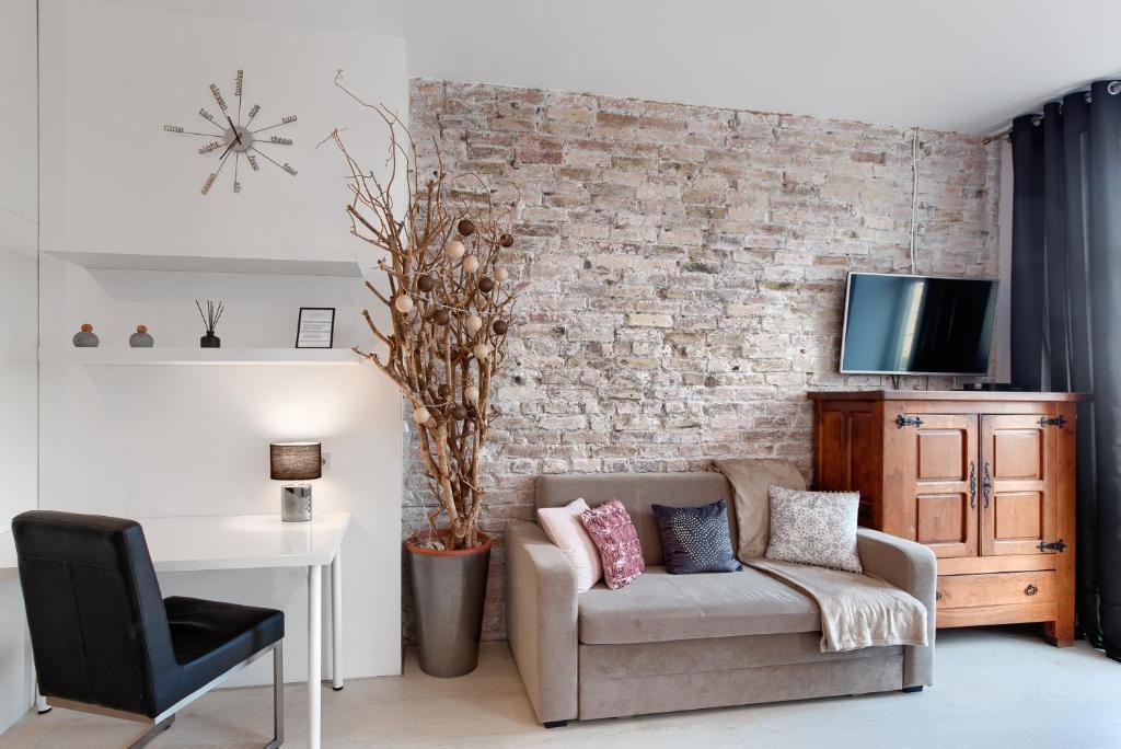 Ein Sitzbereich in der Unterkunft Apartament 111 - Apartamenty No.1
