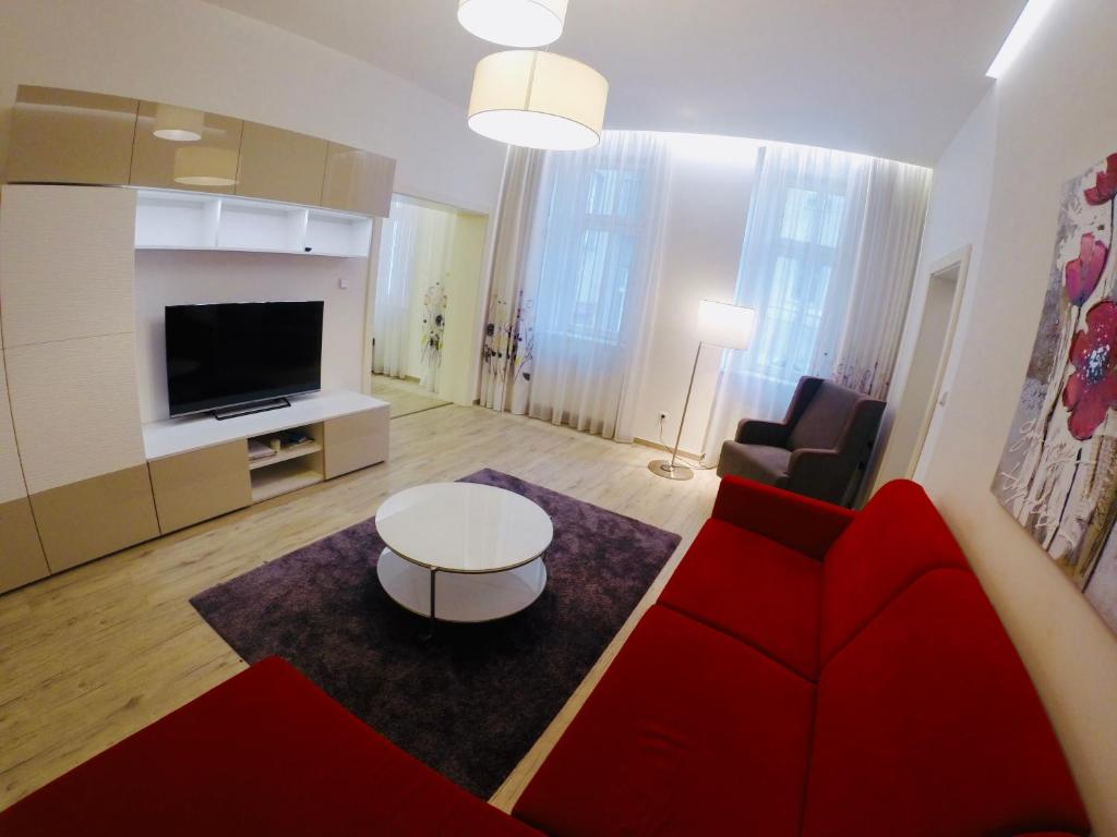 A seating area at New City Centre Apartment