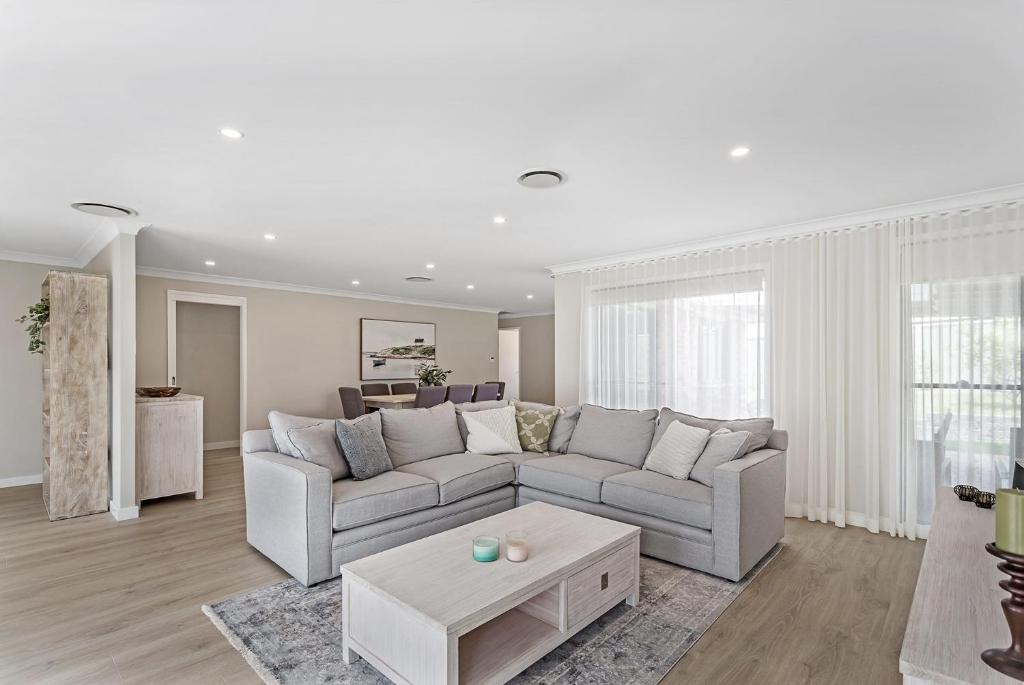 A seating area at Wirragulla, 10 Marty Avenue - Stylish Modern House with ducted air con & WIFI