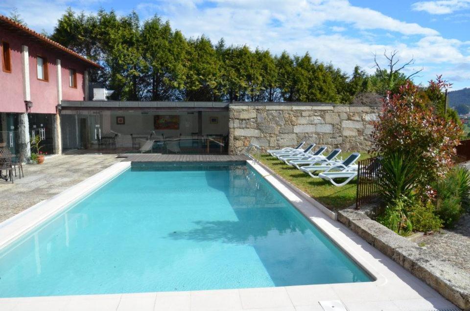 The swimming pool at or near Moradia Integrada T0 em Hotel Rural 4.*