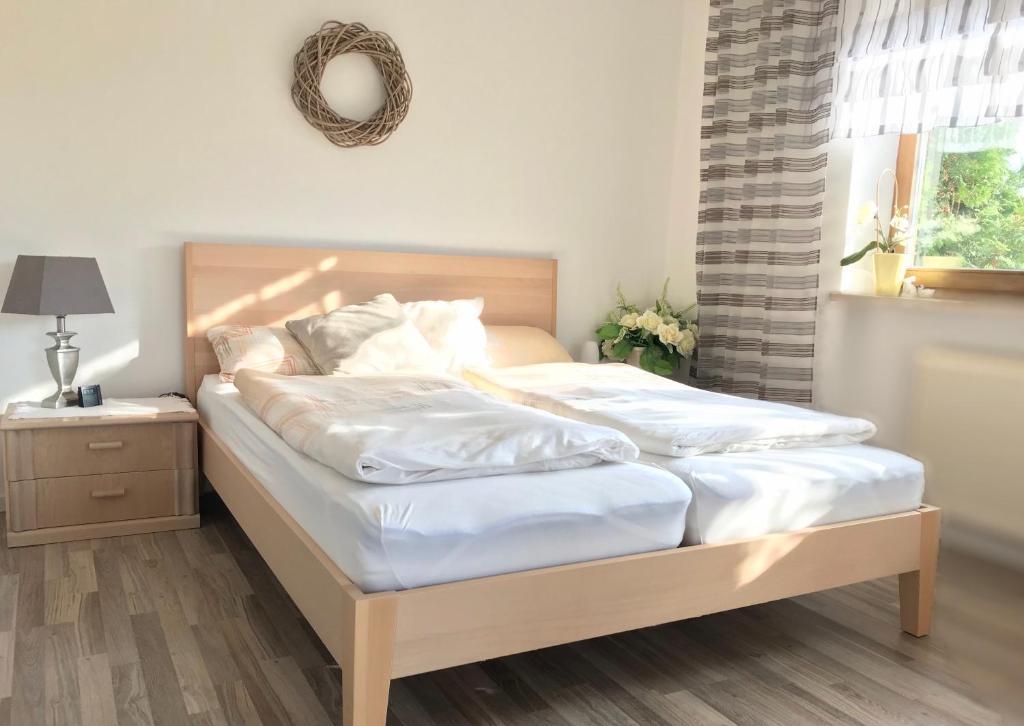 Ein Bett oder Betten in einem Zimmer der Unterkunft Apartment am Stadtpark