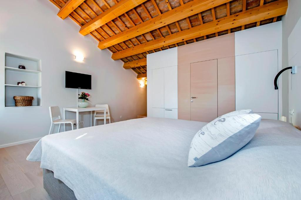 A bed or beds in a room at Casa Bruno