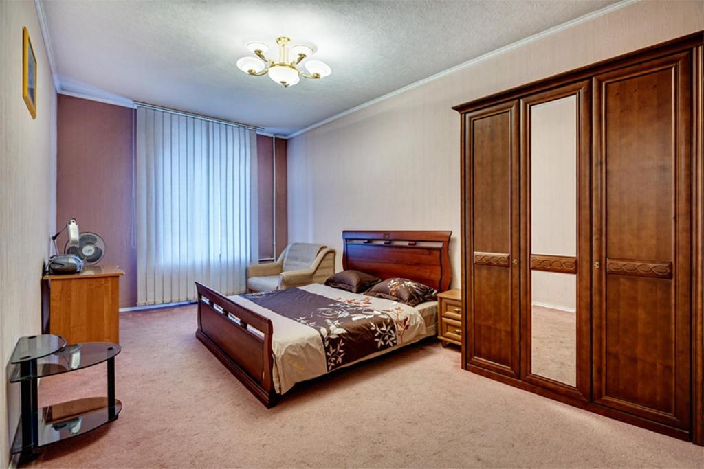 A bed or beds in a room at Apartments near Khreshchatyk-Absolut