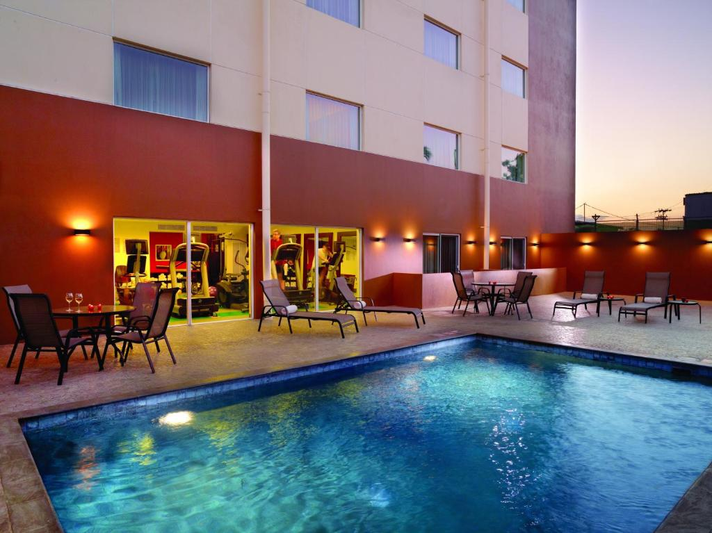 Piscina en o cerca de Courtyard by Marriott San Jose Airport Alajuela