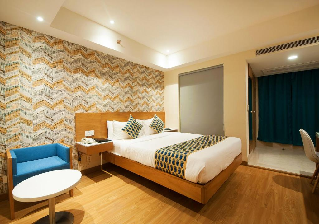 A bed or beds in a room at The Orion Plaza - Nehru Place