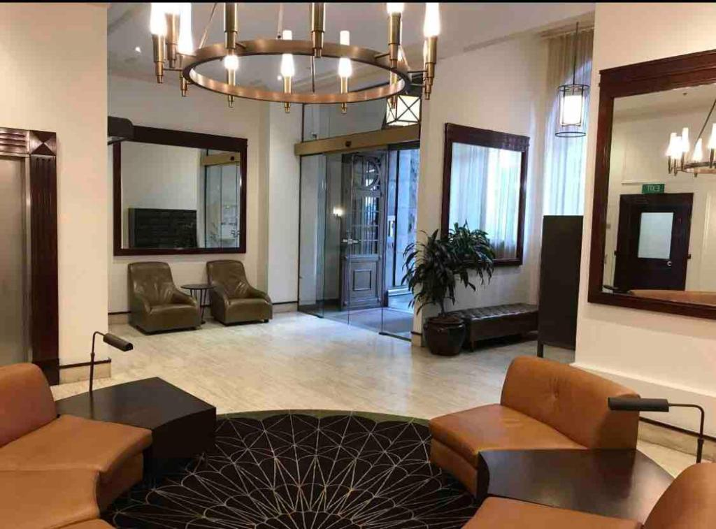 The lobby or reception area at Entire CBD Home + 5 star Hotel Beds+5G Internet+Shared Swimming Pool