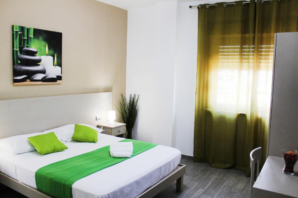 A bed or beds in a room at Hotel Cesirja