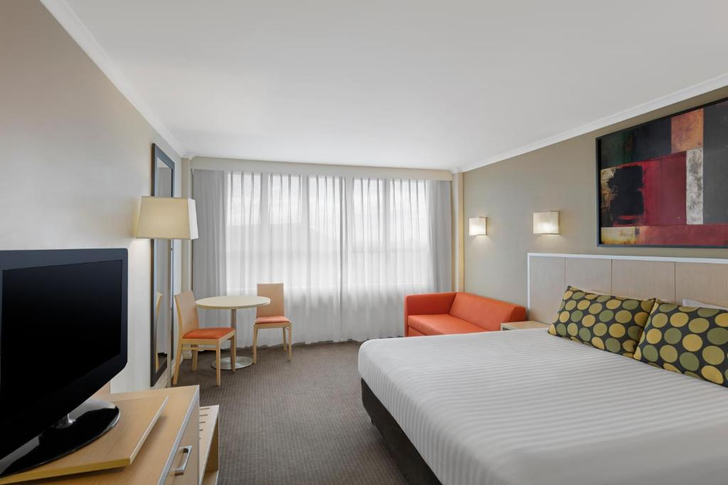 A bed or beds in a room at Travelodge Hotel Newcastle