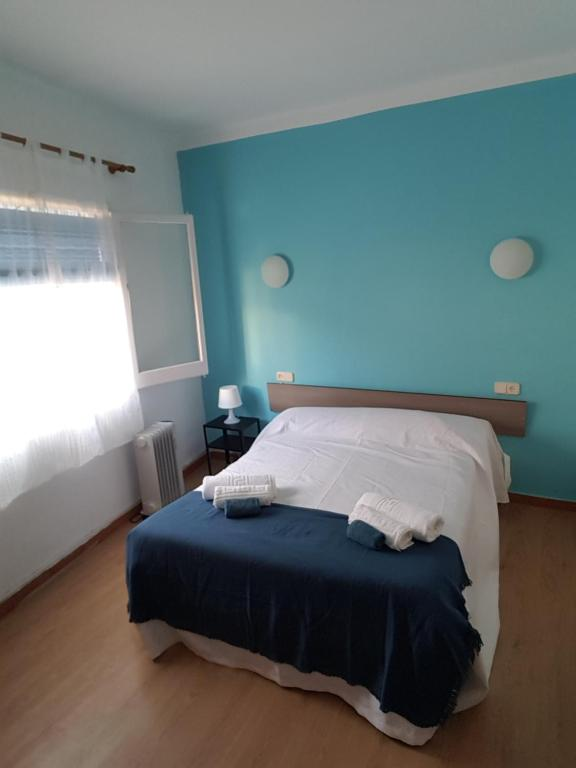 Cama o camas de una habitación en Hostal Pancheta
