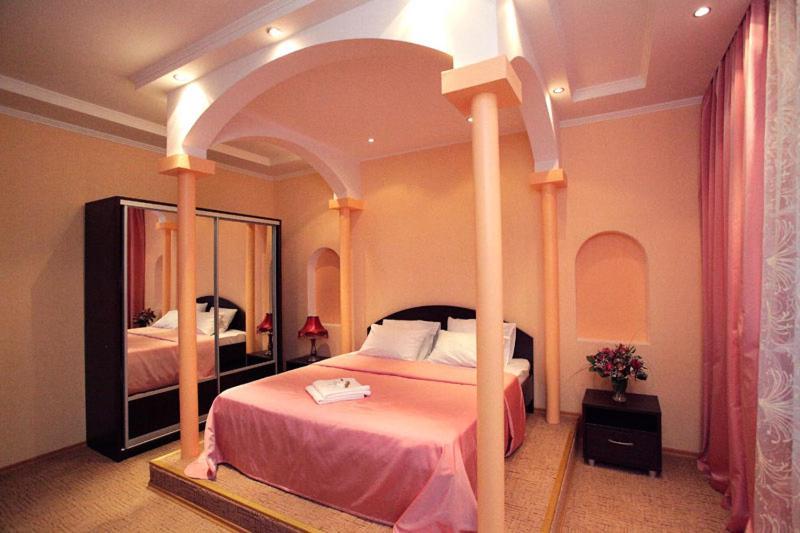 Кровать или кровати в номере Гостиница Атаман