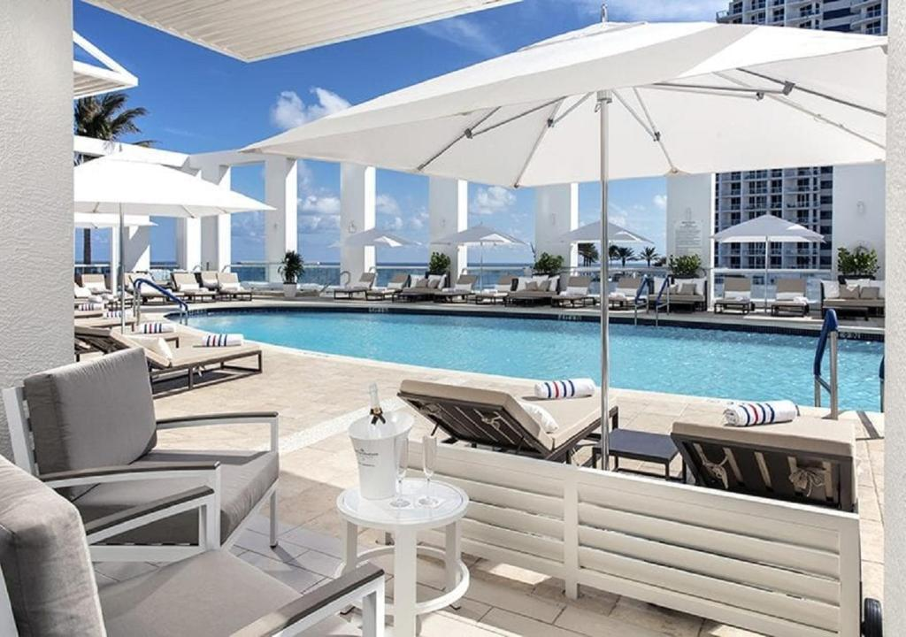 The swimming pool at or near Conrad Fort Lauderdale Beach
