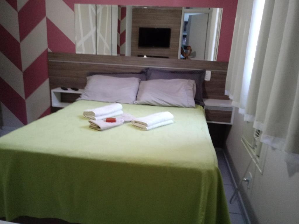 A bed or beds in a room at Espaço Relax em condominio clube